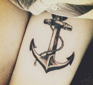 A realism nautical tattoo of an anchor