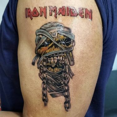A cartoon-style tattoo of the iconic mummy off Iron Maiden's Powerslave album by Aatman Tattoos