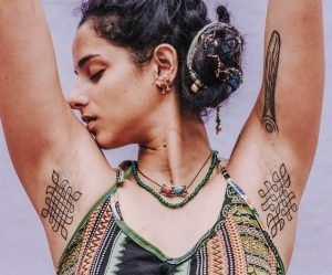 A minimalism underarm tattoo of a kolam pattern by Inkadelik