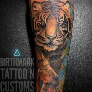 A colourful realism tattoo by Birthmark Tattoo n' Customs