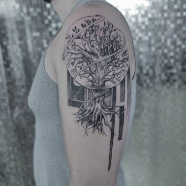 A blackwork abstract tattoo of a tree with roots by InkOverMatter