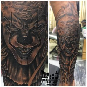 A hyper-realism tattoo of the clown from IT by Tattoo Trends