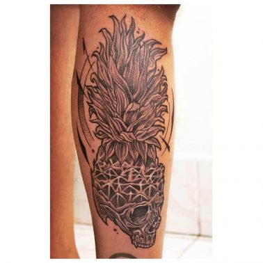 A blackwork tattoo of a skull with a pineapple head by Inkadelik