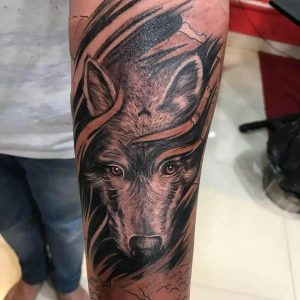A realism portrait tattoo of a wolf by Aatman Tattoos
