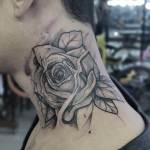 A blackwork tattoo of a flower by InkOverMatter