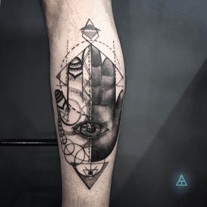 A blackwork abstract tattoo of the Hamsa symbol by Birthmark Tattoo n' Customs