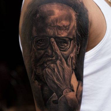 A hyper-realism portrait tattoo of south Indian star Rajinikanth by tattoo artist Sanket Patel of Aliens Tattoos