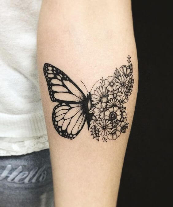 A neo-traditional blackwork tattoo of a butterfly