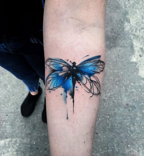 A watercolour tattoo of a dragonfly
