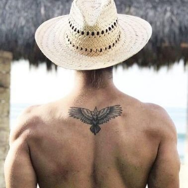 A minimalism tattoo of an eagle on the back