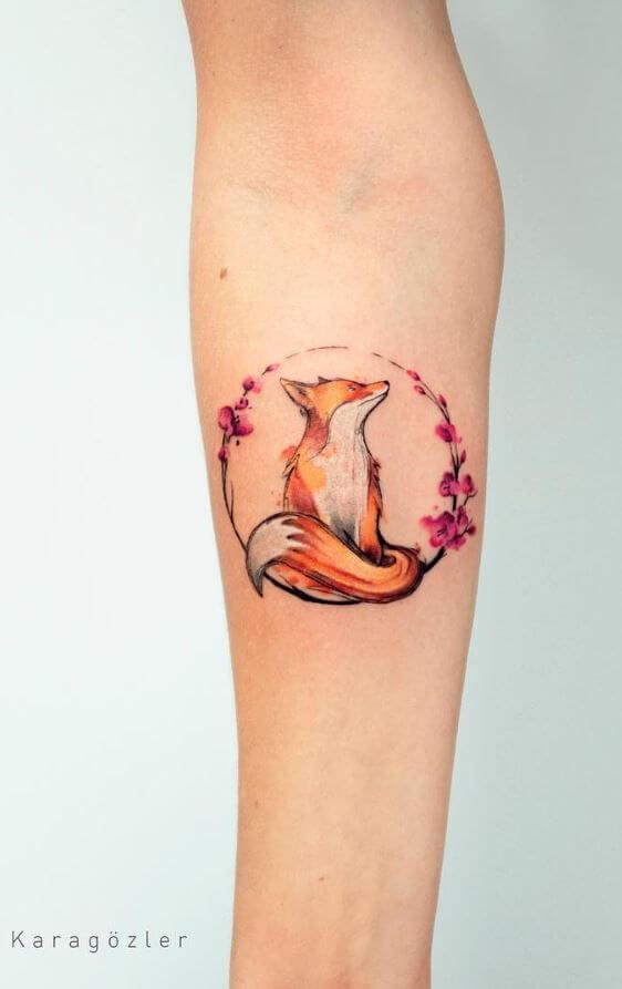 A minimalist neo-traditional and watercolour tattoo of a fox