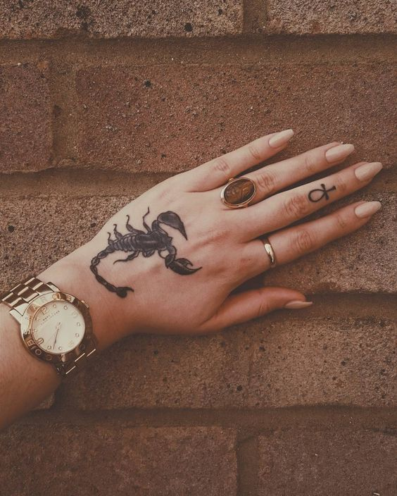 A realism tattoo of a scorpion