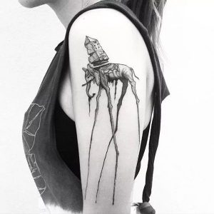 A blackwork tattoo of the elephants featured in a painting series by surrealist Salvador Dali