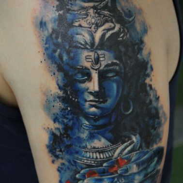 A colourful realism tattoo of Lord Shiva by tattoo artist Sameer Patange of Kraayonz Tattoos