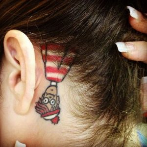 A new school tattoo of Wally, also called Waldo, on the side of the neck hidden under the hair