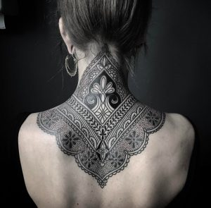An ornamental neck tattoo using patterns from both mandala and henna designs