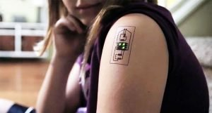 A health-monitoring electronic tattoo, also called an 'e-tattoo', worn on the bicep