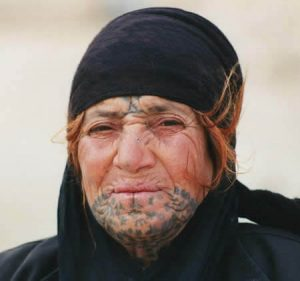 A bedouin woman from Syria with tribal face tattoos