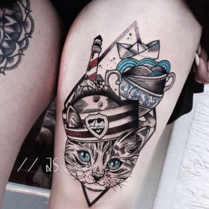 An abstract tattoo featuring a cat and teacups by Jessica Svartvit
