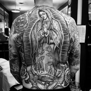 A traditional tattoo of the Christian Virgin Mother Mary in the Chicano style
