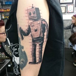 A new school graffiti tattoo of an old robot