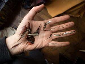 A hyperrealism illusion tattoo of a bio-mechanical hand