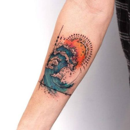 A colour tattoo featuring an illustration of waves and the sun