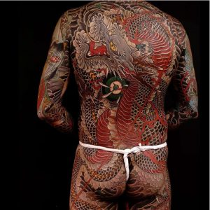 A traditional Japanese Irezumi tattoo of a dragon in a full body suit using illustrative colourful designs