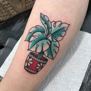 An old-school American classic tattoo of a potted plant