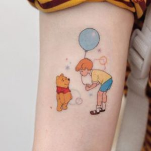 A minimalism fine line tattoo of characters from Winnie the Pooh