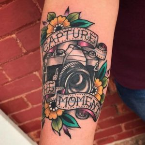 An old-school American classic tattoo of a camera