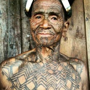 A headhunter from Nagaland displays the tribal tattoos he earned after hunting an animal and returning with its head