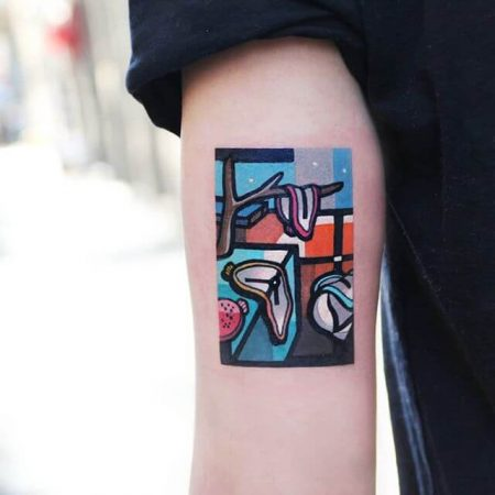 Dali's 'The Persistence of Time' as a watercolour tattoo by artist polyc_sj