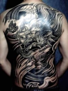 A blackwork tattoo of a Chinese dragon covering the whole back