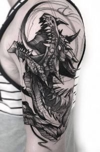 A detailed sketch-style blackwork tattoo of a Celtic dragon on the bicep