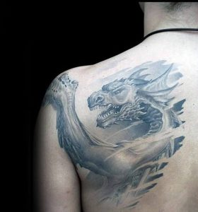 A blackwork grey dragon tattoo of a Celtic dragon on the shoulder blade