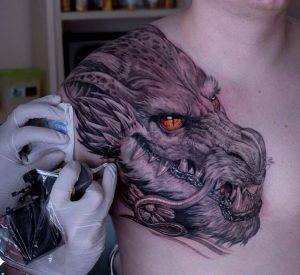 A hyperrealistic tattoo of a Celtic dragon on the shoulder