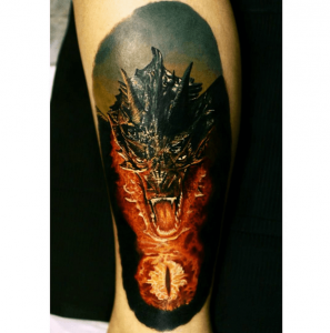 A realism tattoo of the animated dragon Smaug from the Lord of the Rings series based on Tolkien's novels