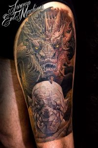 A hyperrealism colour tattoo of the characters Smaug and Azog from the Lord of the Rings franchise