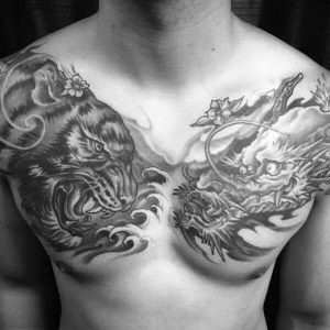 A blackwork tattoo of the Chinese deities represented by the White Tiger and the Azure Dragon on the chest