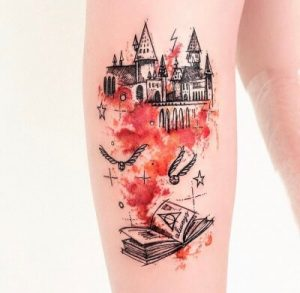 A watercolour tattoo of Hogwarts featuring the Deathly Hallows and Snape's infamous 'Always'