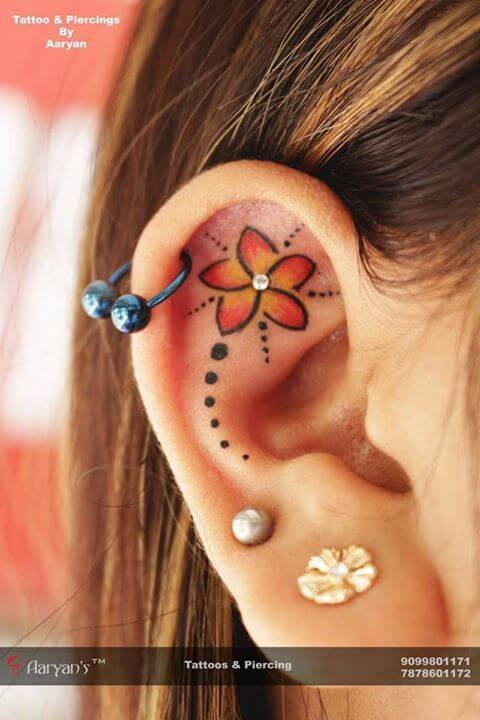 Girls ear tattoo with piercing
