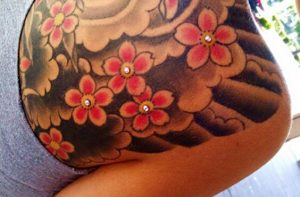 Girls back tattoo with piercings