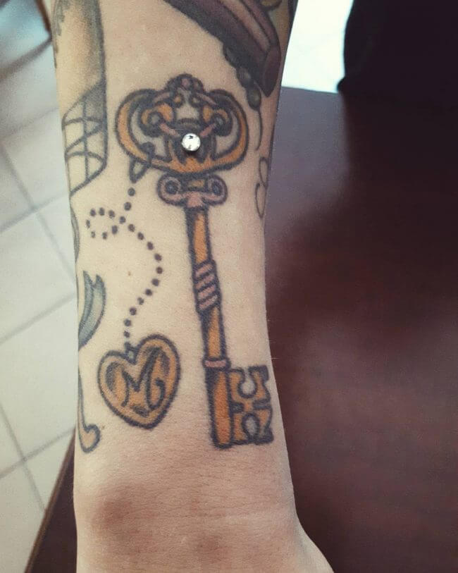 Old-school tattoo of a key with a piercing