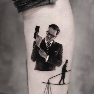 A microrealism tattoo of Harry from Kingsman: The Secret Guard