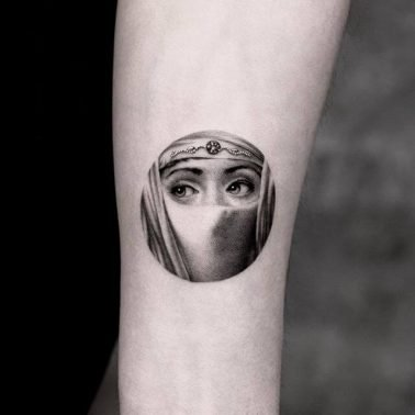 A microrealism tattoo of a painted plate from Fornasetti featuring operatic soprano Lina Cavalieri by Tattooist Yeono