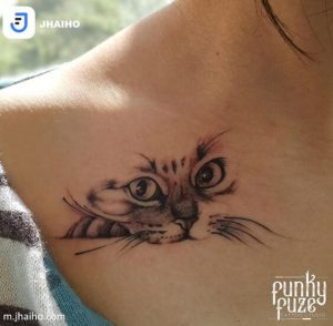 A linework realism tattoo of a cat on a girl's chest