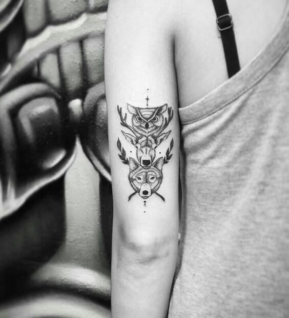 Minimalist tattoo of animal totems from Native American culture