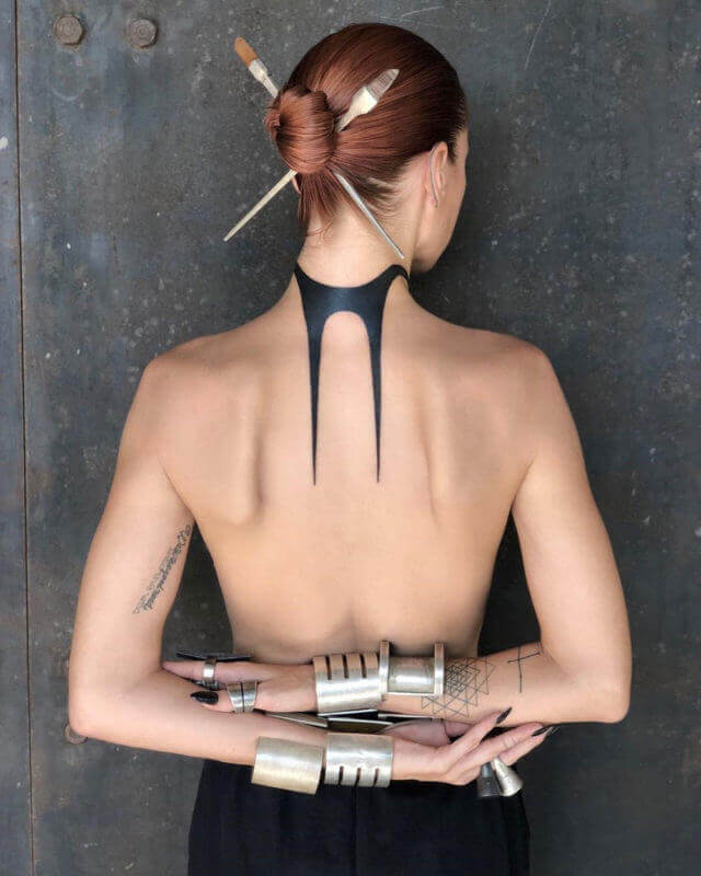 An abstract neck and back tattoo