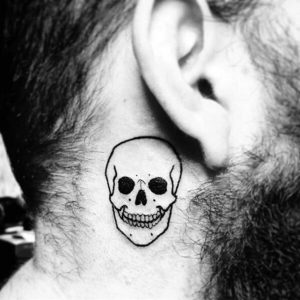 A linework tattoo of a skull on the side of the neck